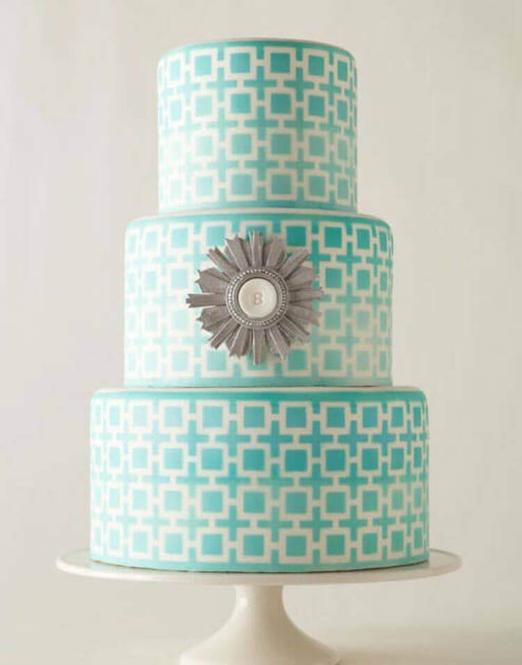 This tile style cake is so effective, the colour is also beautiful being such a soft turquoise. It's amazing what a stencil and some paint can do for a cake!