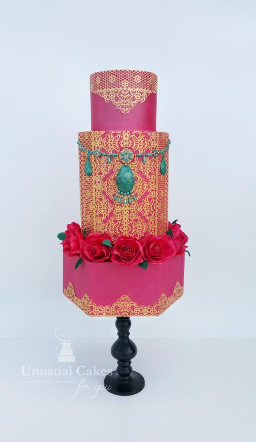 This three tiered cake is by Unusual Cakes for You and was made as a collaboration to celebrate Indian Fashion as seen here. Well this is quite the masterpiece. It 's so bold and really stands out as an amazing creation. Complete with sugar roses, henna design and pink and turquoise colour scheme, this is really set to impress.
