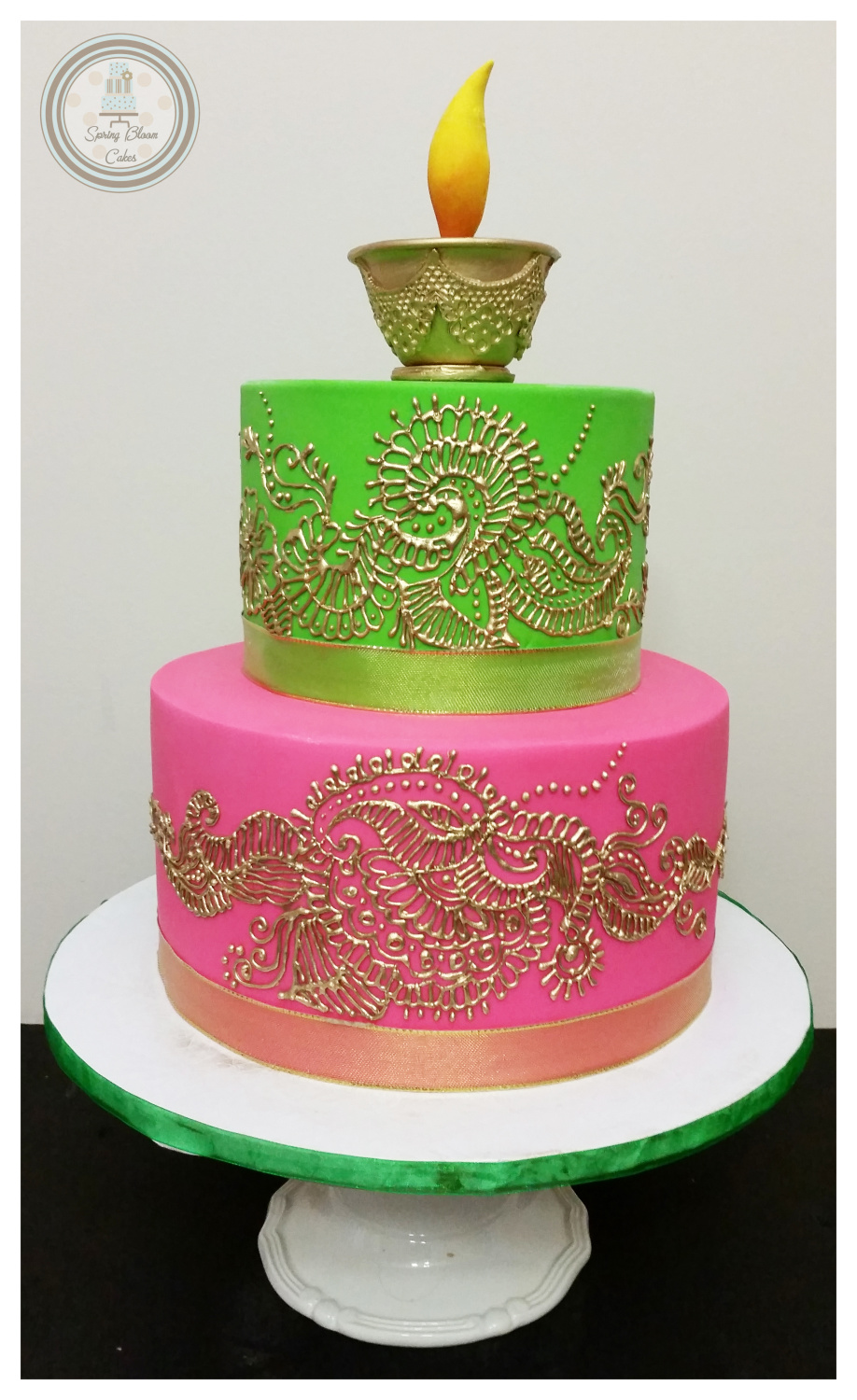 This bold cake is from Deepa Mathan at Spring Bloom Cakes. They specialise in custom made wedding cakes an are based in Ajax, Ontario. We love the bright colours in this cake, paired with the amazing gold Henna design. It looks perfect for a birthday celebration and will really wow.