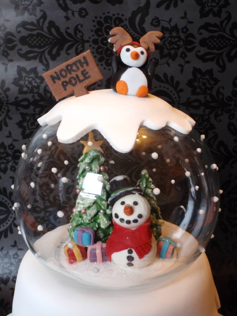 This cake is from Cindy at Cindy's Cake Creations. She bakes from home in the South East of Melbourne and makes some very cool cakes. We thought this was such a good idea for a Christmas themed cake, a snow globe! How cool! She's done very well to keep all the models and cake intact and looking pristine inside their globe.