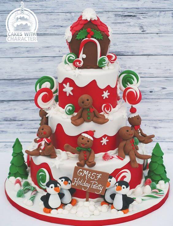 This tiered Christmas cake is by Jean at Cakes with Character. She is an award winning cake artist and is based in Long Island, New York. We love the design on this tiered Christmas Cake. The red tiers are so bold and the little model Penguins and Gingerbread men are so sweet. The trees and candy canes really bring the whole cake together.