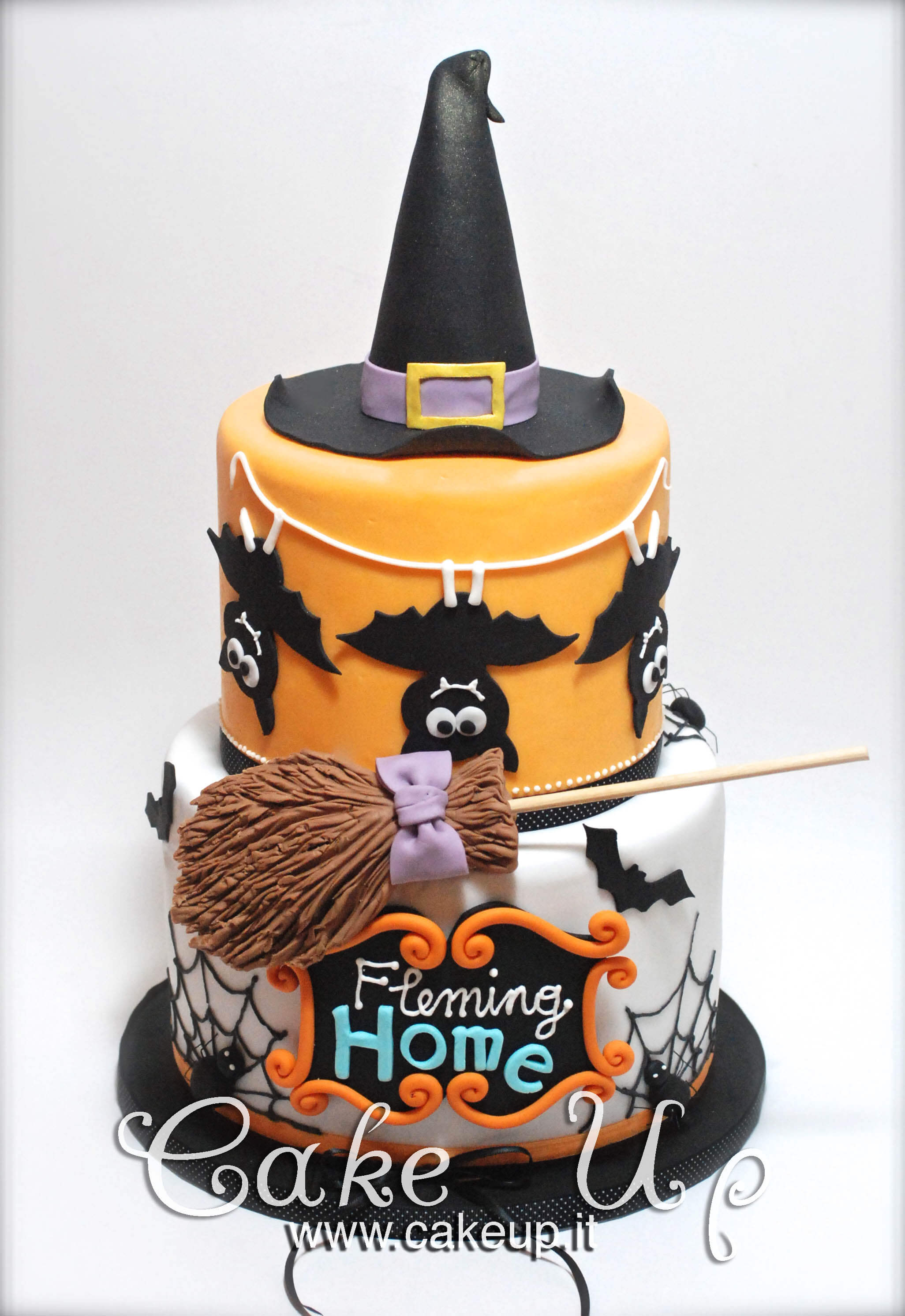 This one is from Cake Up Sweet Creations, based in Italy. This is a very cool tiered cake that is perfect for Halloween. The array of colours and even handmade broom stick really make this cake stand out and will dominate any Halloween party.
