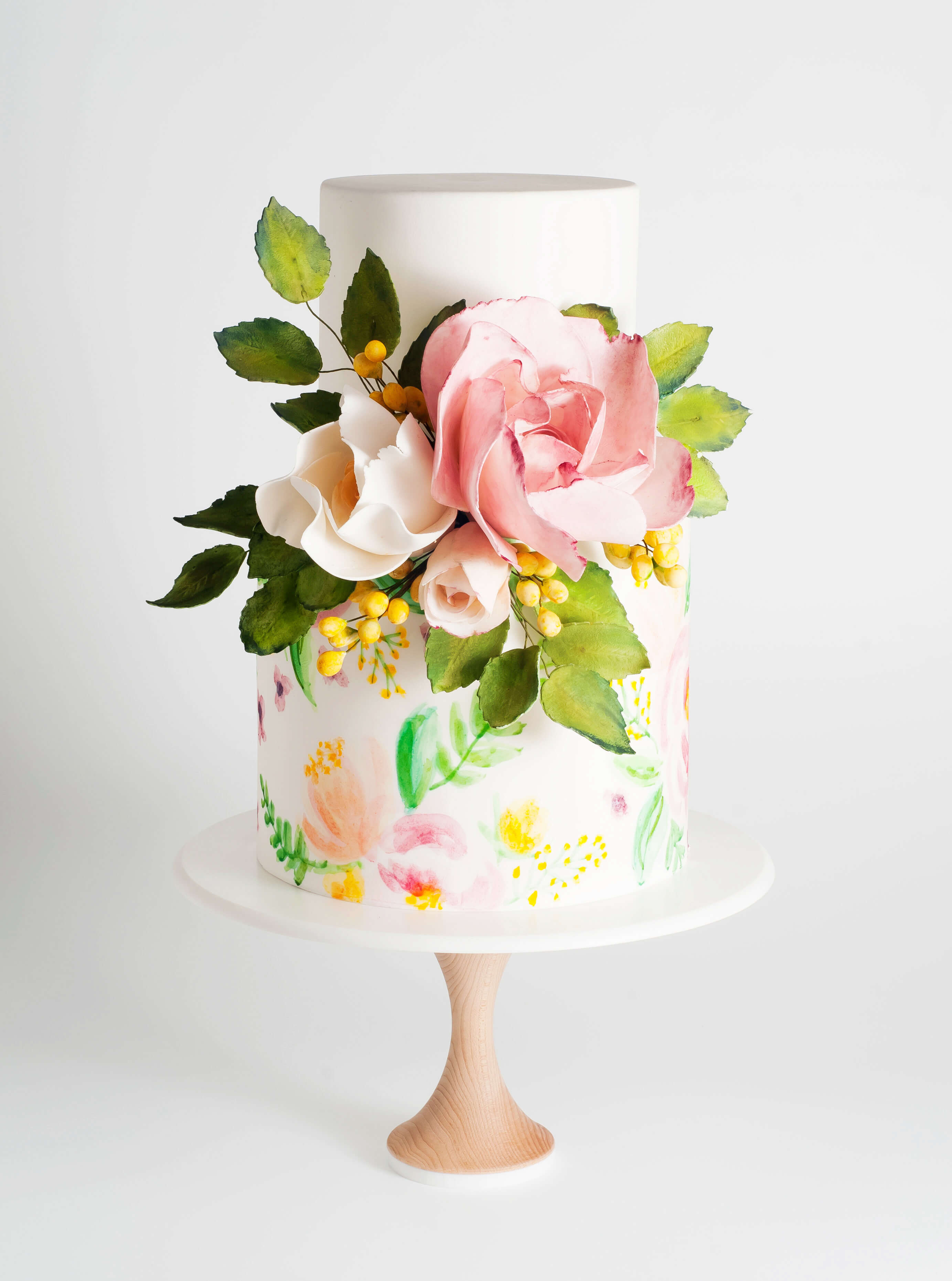 A more modern style cake with great pops of colour, comes from Janelle Dedini, owner of Melbourne Based Cake Ink.  Beginning in 2009, Cake Ink create custom cakes that are modern and elegant and have an abundance of technical sugar work.  We loved this cake with it's really bright colours and the combination of watercolour painted flowers on the bottom tier, with a burst of sugar flowers in the centre. This would be a perfect celebration cake and one we would be very happy to receive.