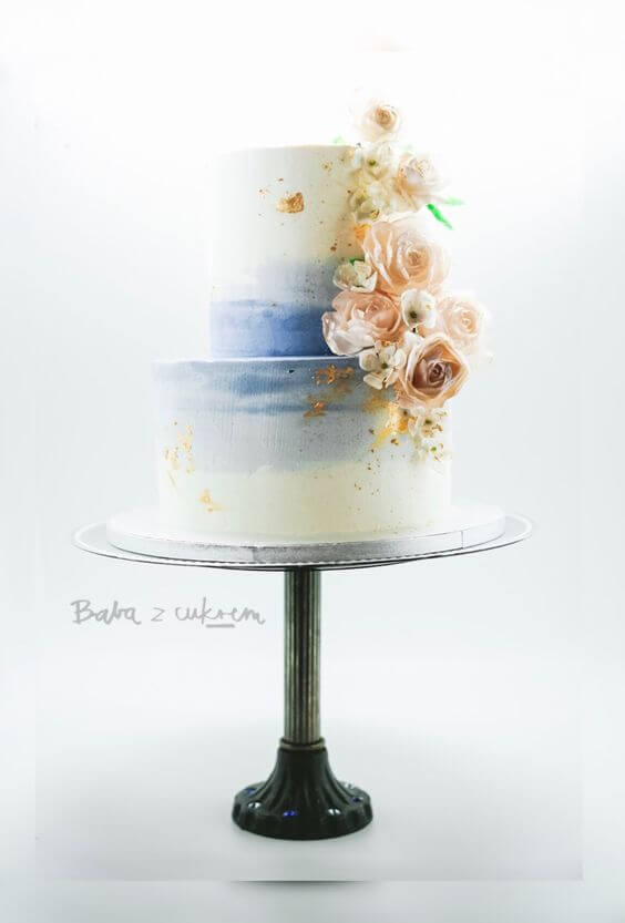 This cake is by Baba z Cukrem!  We love this cake, with statement wafer paper flowers and flecked gold leaf. The colours make this cake really stand out and the wafer flowers are beautifully made.